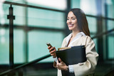 Portrait of young businesswoman going to office - 212223447