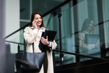 Portrait of young businesswoman going to office - 212223463