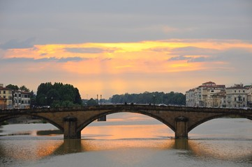 Ponte Alla Carraia Bridge at sunset on the Arno River, in Florence, Italy