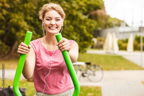 Aluminium Fitness Active woman exercising on elliptical trainer.