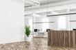 White office corner, wooden reception, plant