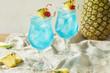 Leinwanddruck Bild - Boozy Blue Hawaii Hurricane Cocktail