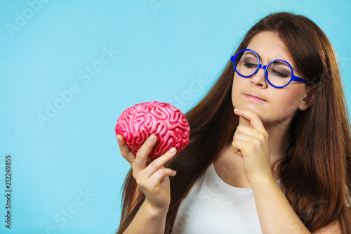 Woman with fake brain thining