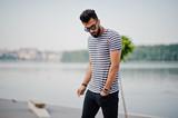 Handsome tall arabian beard man model at stripped shirt posed outdoor. Fashionable arab guy at sunglasses. - 212277410