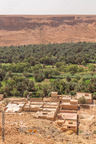 Fotobehang Zalm Houses by the River Oasis in Morocco
