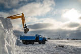 Clearing snow in the Arctic, dump trucks take it out..