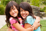 Sisters laughing and playing together. - 212299465