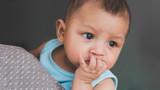 baby boy  sucking fingers - 212305037