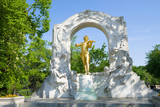 Monument to Johann Strauss in the city park on a sunny afternoon. Vienna - 212305067