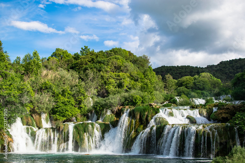 The main waterfalls of the natural park of Krka a strong torrent of water that descends towards the lake. Photograph taken in Sibenik, Croatia.