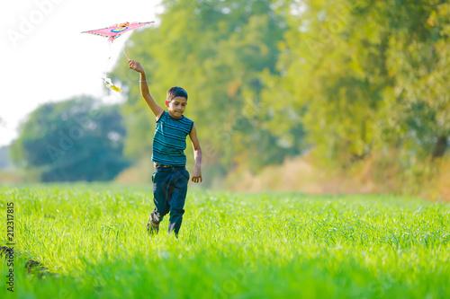 Fototapeta indian child playing with kite