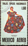 Mexican woman traditionally dressed on postage stamp - 212324011