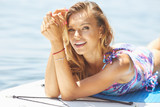 Young sexy woman with surf board on the beach, ready for surfing. Waving hand. Positive emotions. Close up - 212327007