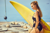 Young sexy woman with surf board on the beach, ready for surfing. Waving hand. Positive emotions. Close up - 212327040