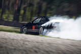 Sport car wheel drifting. Blurred of image diffusion race drift car with lots of smoke from burning tires on speed track