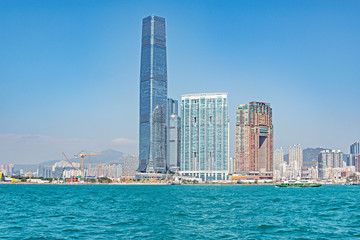 Day view of a harbour and Kowloon peninsula. © serjiob74