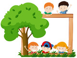 Blank frame surroeded by children and tree - 212332066