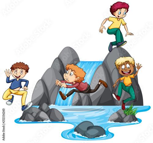 Boys Playing at Waterfall