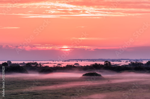 Aluminium Zonsopgang Colorful landscape with fog over the fields during sunrise.