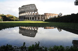 Colosseum in rome reflected in the water
