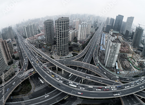 Plexiglas Shanghai Aerial view of highway and overpass in city on a cloudy day