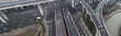 Aerial view of highway and overpass in city on a cloudy day - 212350635