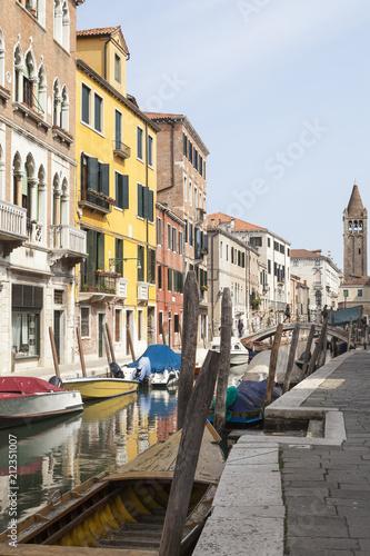 Rio San Barnaba, Dorsoduro, Venice, Veneto,  Italy with reflections in the canal  - 212351007