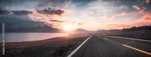 Lake and road  at sunset