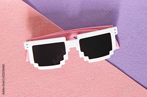 White Pixel glasses on a pink and purple background