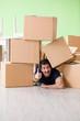 Leinwanddruck Bild - Man moving house with boxes