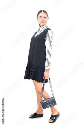 Asian girl and female bag isolated from white background.
