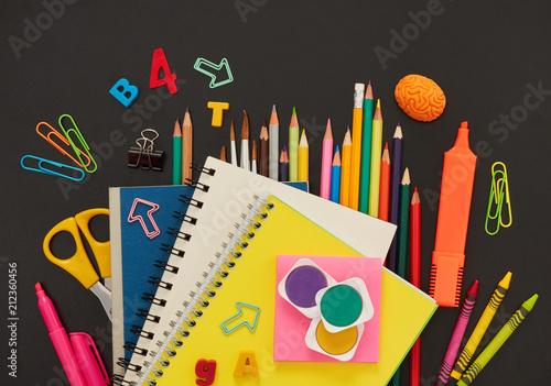 Chalkboard with school supplies - 212360456