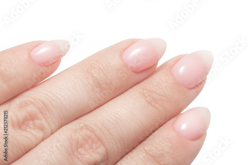 Aluminium Manicure Women's hands with perfect Nude manicure. Nail Polish is a natural pale pink shade. Isolated on white