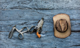 old cowboy hat and revolver - 212375681