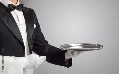 Waiter serving with white gloves and steel tray in an empty space  - 212378622