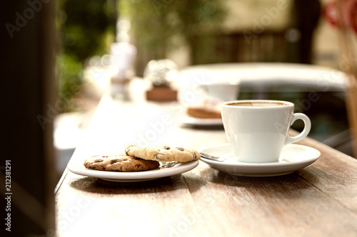 Poster Detail of a cup of coffee and plate with biscuits