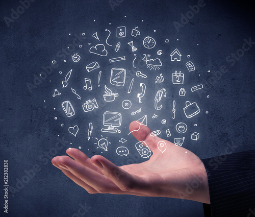 Mixed white media and communication related icons hovering above young hand  - 212382830