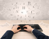 First person view of an elegant businessman hand  typing with fluttering papers around  - 212383642