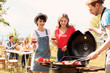 Leinwanddruck Bild - Young people having barbecue with modern grill outdoors