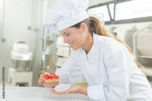 Young pastrycook at work