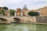 Ponte Vittorio Emauele II with St. Peter's Basilica in background across Tiber river in Rome, Italy