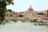 Ponte Sant' Angelo with St. Peter's Basilica in background across Tiber river in Rome, Italy