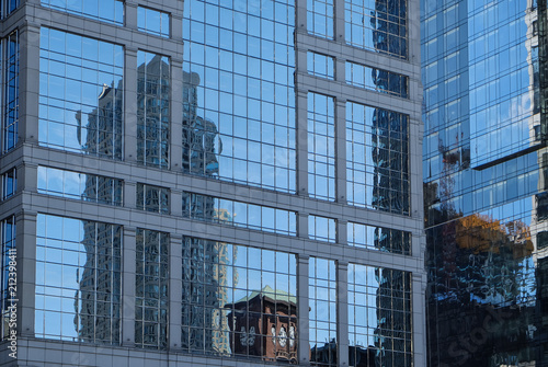 Fotobehang Chicago Reflections in the glass exterior of a Chicago building - 2
