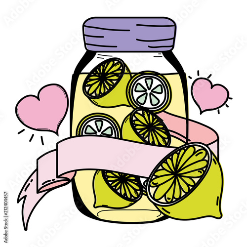 color delicios lemon juice in the mason with heart and ribbon