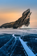 Rock on frozen winter water lake Siberian Baikal Russia natural landscape background
