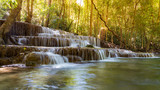 Tropical deep forest waterfall, natural landscape background