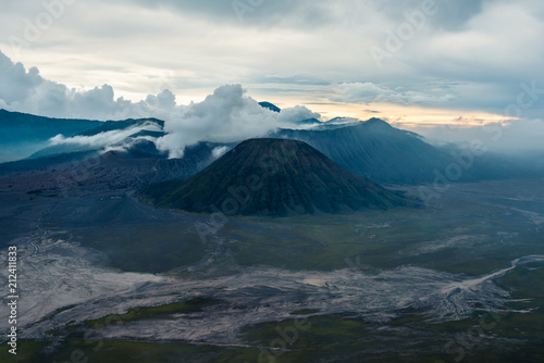 Fotobehang Groen blauw view of Mount Bromo under cloudy sky with the sand sea