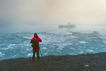 Photographer take a photo at ice in Iceland. © tawatchai1990