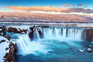 Godafoss waterfall at sunset in winter, Iceland. © tawatchai1990