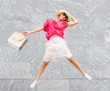 happy woman jump with shopping bag